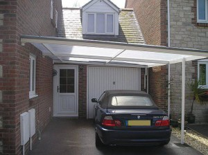 traditional-white-carport-in-front-of-bmw-garage